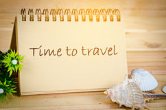 Time to travel note with day light. Time to travel note with day light on wooden background Stock Images