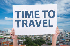 Time To Travel sign Hands holding blank paper over. Head background panoramic aerial view big city town and blue sky Royalty Free Stock Image