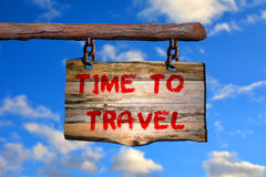 Time to Travel sign. On old wood with a blurred beach on background Stock Photo