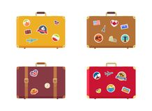 Time to Travel Suitcase with Magnets Souvenirs. Time to travel set of suitcases with magnets souvenirs from USA France, Great Britain Italy Egypt Canada and Royalty Free Stock Images
