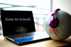Time to travel text on PC screen. Travel concept. Lifestyle. Work online and travel Royalty Free Stock Images