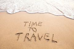 Time to travel, tourism. Time to travel, concept text drawn on sand of beach Royalty Free Stock Photography