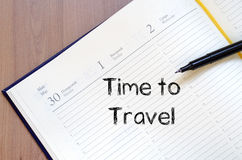 Time to travel write on notebook. Time to travel text concept write on notebook with pen Royalty Free Stock Photo
