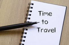 Time to travel write on notebook. Time to travel text concept write on notebook with pen Royalty Free Stock Images