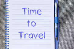 Time to travel write on notebook. Time to travel text concept write on notebook with pen Royalty Free Stock Photos