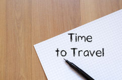 Time to travel write on notebook. Time to travel text concept write on notebook with pen Royalty Free Stock Image