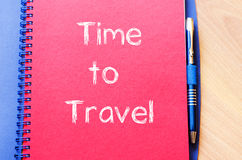 Time to travel write on notebook. Time to travel text concept write on notebook with pen Stock Image