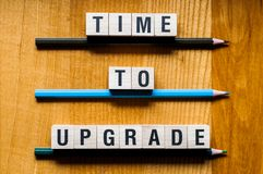 Time to upgrade words concept stock photography