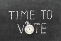 Time to vote. Phrase handwritten on chalkboard with vintage precise stopwatch used instead of O royalty free stock image