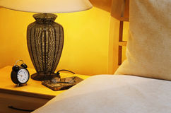 Time To Wake Up. Close Up Fragment Of The  Bedroom With Reading Lamp And Alarm Clock Royalty Free Stock Photography