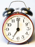 Time to wake up. Old-fashioned alarm clock is ringing royalty free stock photo