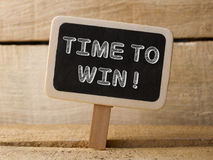 Time to win. Business Concept.  text write on Chalkboard at wooden background.  Royalty Free Stock Images