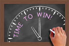 Time to Win. Concept drawn on blackboard with chalk in hand Stock Images