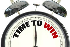 Time to win. Text printed on a clock face royalty free stock photography