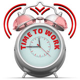 Time to work. The alarm clock with an inscription Royalty Free Stock Photo
