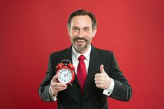 Time to work. Businessman care about time. Time management skills. How much time left till deadline. Manager with alarm. Clock. Man bearded businessman hold royalty free stock images