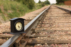 Time on Track. A clock on a railroad track getting the time right back on track Royalty Free Stock Photos