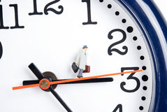 Time travel. Traveler on clock in time stock photos