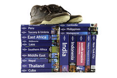 Time for travel. Collection of travel books with various destinations and shoes Royalty Free Stock Images