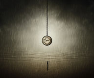 Time travel. Surreal backround of a man standing with wide opened hands in front of a huge clock near the ocean in a rainy day. End of time. Time travel concept royalty free stock images