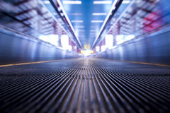 Time Tunnel. Place camera on the floor of escalator Stock Image