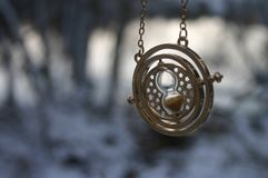 Time turner. Harry Potter time turner gold Royalty Free Stock Photos
