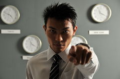 Time is Urgent 4!. Picture of Asian model with many clocks from different city. Useful for showing time urgency or time related messages. Note that lighting Royalty Free Stock Images