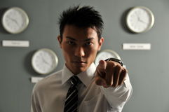 Time is Urgent 5!. Picture of Asian model with many clocks from different city. Useful for showing time urgency or time related messages. Note that lighting Stock Photo