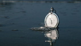 Time for vacation concept background. Pocket clock and sea waves on sunset stock footage