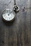 Time - Vintage Pocket Watch on Weathered Wood Background Royalty Free Stock Photography