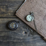 Time - Vintage Pocket Watch on Weathered Wood Background. From above Stock Photo