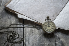 Time - Vintage Pocket Watch on Weathered Wood Background. Close up Royalty Free Stock Photography