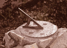 Time. A vintage sundial shot in sepia royalty free stock photos