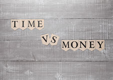 Time vs money paper letters symbol motivation sign Royalty Free Stock Photos