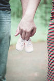 It is time for waiting a baby. Little shoes Stock Photos