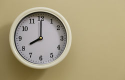 Time for wall clock 8:00. Which hung over the wall Stock Image