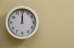 Time for wall clock 12:00. Which hung over the wall Royalty Free Stock Photography