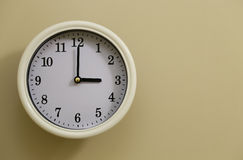 Time for wall clock 3:00. Which hung over the wall Stock Photo