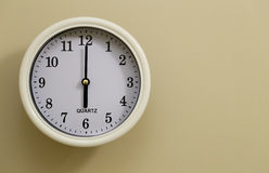 Time for wall clock 6:00. Which hung over the wall Royalty Free Stock Images