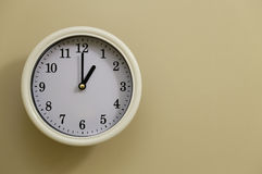 Time for wall clock 1:00. Which hung over the wall Royalty Free Stock Photos