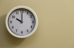 Time for wall clock 10:00. Which hung over the wall Stock Photography
