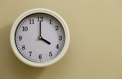 Time for wall clock 4:00. Which hung over the wall Stock Photos