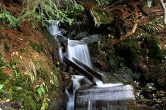 Time of the water. Mountain waterfall in slow motion royalty free stock photography