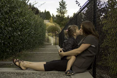 Time well spent. Little girl sits with mom Stock Photos