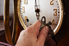 Time Winder. The table top clock maintenance takes a key to wind it Royalty Free Stock Photography