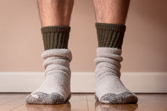 Time for winter socks. Man wearing warm wool winter socks Royalty Free Stock Images