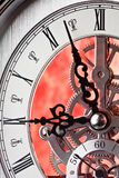 Time for work. Close up of a Clock Showing Gears. Time is almost Nine-o-clock stock image
