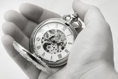 Time in your hands. Hand holding a vintage clock, black and white Stock Images