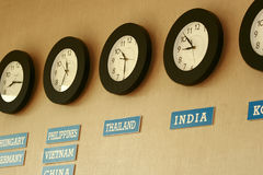Time Zone. Clocks on a wall with time zone of different country stock photography