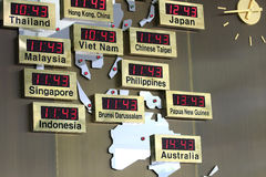 Time Zone. Digital clocks with different asian cities in a map stock photography